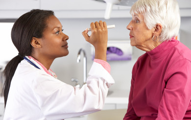 The eyes of an elderly woman are examined by a female doctor